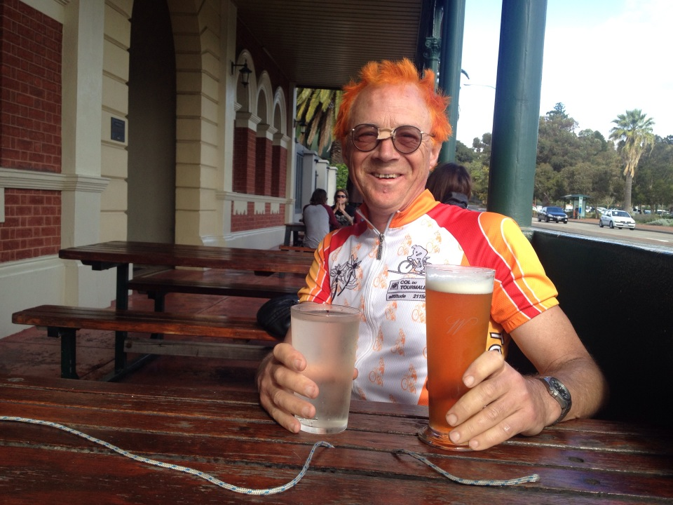 Michael celebrates with a beer.